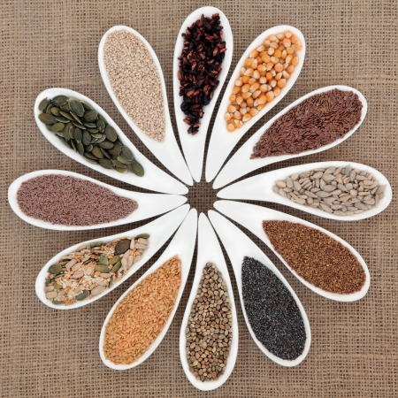 psyllium: Seed food selection in white porcelain bowls over hessian background