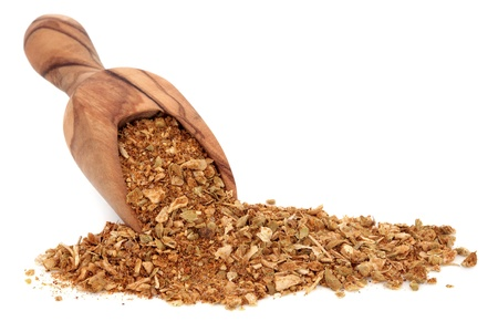 tex mex: Fajita seasoning spice used in tex mex food in an olive wood scoop over white background  Stock Photo