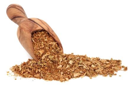 fajita: Fajita seasoning spice used in tex mex food in an olive wood scoop over white background  Stock Photo