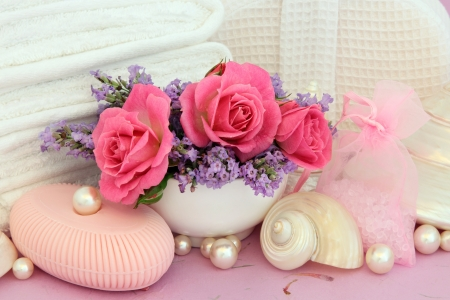 pearl shell: Rose toiletries with lavender flowers, bathroom accessories, pearls and shells over mottled pink background