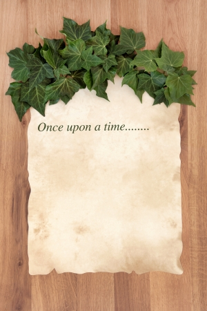 once: Once upon a time story phrase on old parchment with ivy over oak background