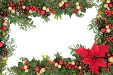poinsettia: Christmas floral border with red poinsettia flower, baubles, holly, mistletoe and winter greenery over white background   Stock Photo