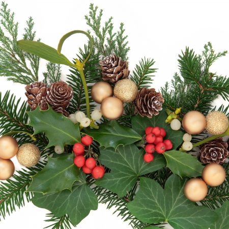christmas greenery decoration with gold baubles holly ivy mistletoe and pine cones over - Christmas Greenery