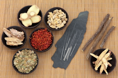 Acupuncture needles with chinese herbal medicine selection over bamboo    photo