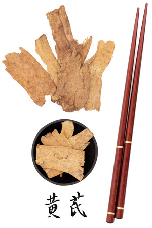 huang: Astragalus root used in traditional chinese herbal medicine with mandarin title script translation and chopsticks  Huang qi   Stock Photo