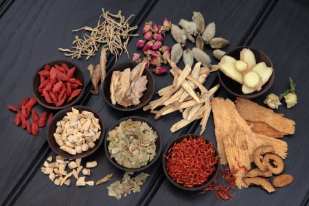 holistic therapy: Chinese herbal medicine selection in wooden bowls and loose