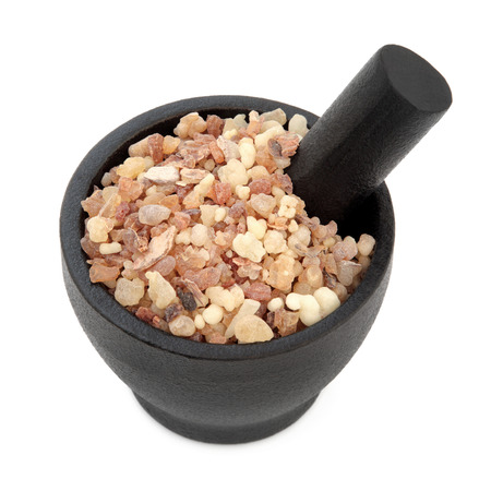 Frankincense: Frankincense and myrrh in a mortar with pestle and bowl over white background