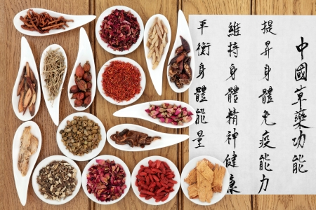 china rose: Traditional chinese herbal medicine with mandarin calligraphy on rice paper over oak background  Translation describes the medicinal functions to increase the bodys ability to maintain body and spirit health and balance energy