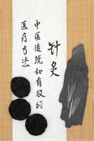 holistic therapy: Acupuncture needles with rehmannia root and mandarin script on rice paper over bamboo  Sheng di huang  Translation describes acupuncture chinese medicine as a traditional and effective medical solution