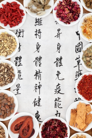 describes: Traditional chinese herbal medicine with mandarin script calligraphy on rice paper  Translation describes the functions to increase the bodys ability to maintain body and spirit health and to balance energy  Stock Photo