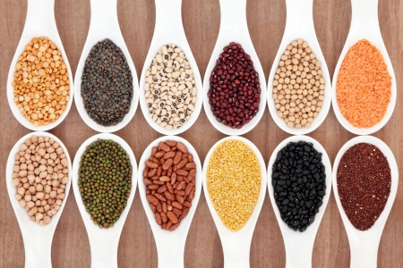 Dried pulses food selection in white porcelain spoons