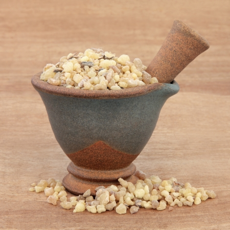 frankincense: Frankincense in a mortar with pestle over papyrus background