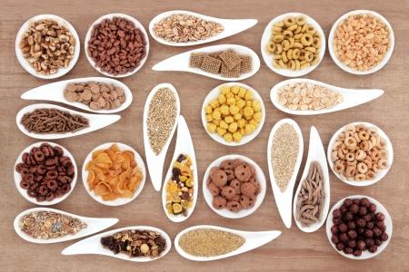 sampler: Large breakfast cereal sampler in porcelain dishes over papyrus background  Stock Photo