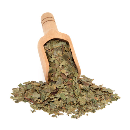 neem: Neem herb used in ayurvedic alternative medicine in a wooden scoop over white background