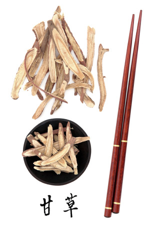 Licorice root chinese herbal medicine with mandarin title script translation and chopsticks  Gan cao   photo