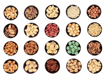 monkey nuts: Large nut selection in wooden bowls over white background  Not a composite