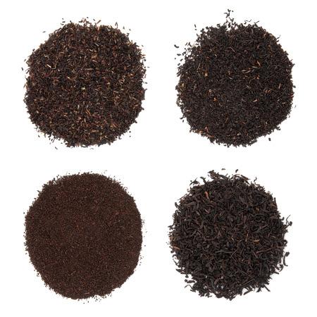 assam tea:  Tea selection of darjeeling, breakfast, assam and earl grey in piles over white background