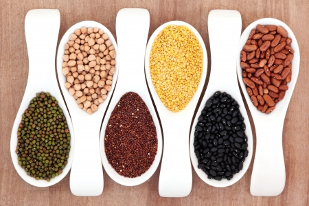 pulses: Pulses selection in white porcelain spoons over papyrus background