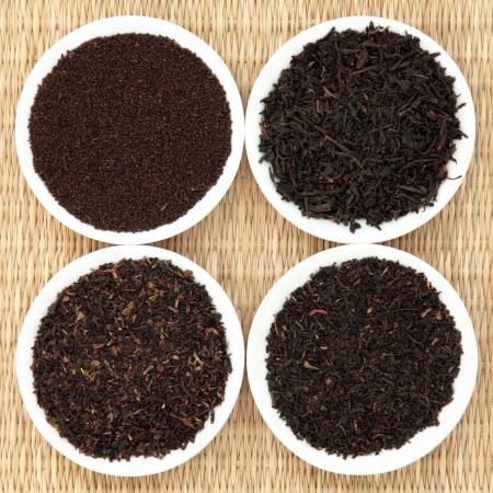 assam: Tea leaf selection of assam, darjeeling, earl grey and breakfast, left to right clockwise