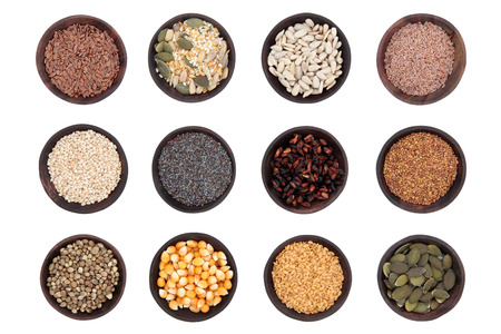 white sesame seeds: Seed food selection in wooden bowls over white background  Stock Photo