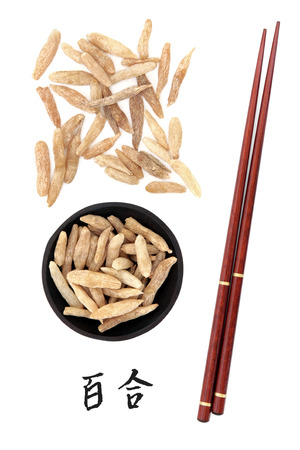 chopstick: Lilyturf root chinese herbal medicine with mandarin title script translation and chopsticks  Mai dong  Ophiopogon japonicus  Stock Photo