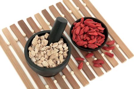 Chinese herbal medicine of ginseng and wolfberry fruit Panax schinsen, ren shen, gou qi zi