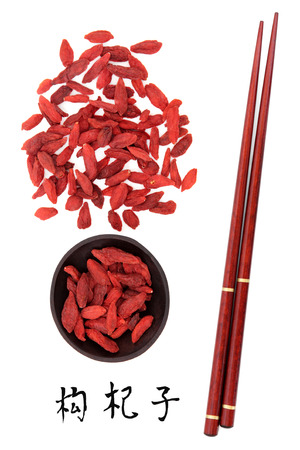 Wolfberry fruit chinese herbal medicine with chopsticks and mandarin script title translation  Gou qi zi  Lycium barbarum fructus  Stok Fotoğraf