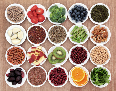 Superfood health food selection in white bowls over papyrus background  Stock Photo