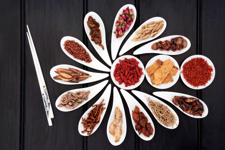 Chinese herbal medicine selection in white china bowls with chopsticks