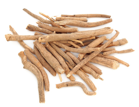 ginseng roots: Ginseng herb in a pile over a white background  Stock Photo