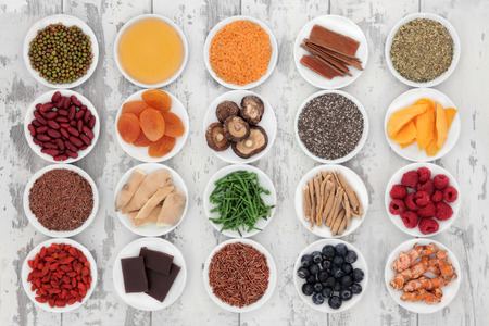 pulses: Healthy super food selection in porcelain bowls over distressed wooden background  Stock Photo