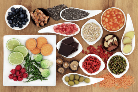 Healthy super food selection over oak wood background  photo