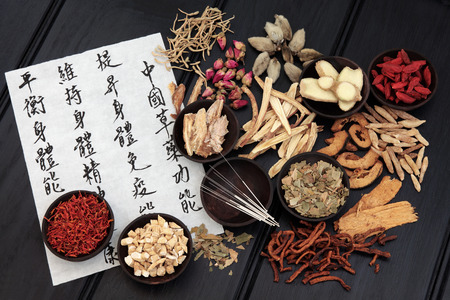 Acupuncture needles with chinese herbal medicine selection and mandarin calligraphy script on rice paper  Zdjęcie Seryjne