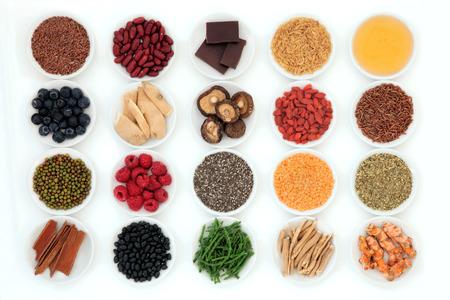 Healthy super food selection in porcelain bowls over white background  Stock fotó