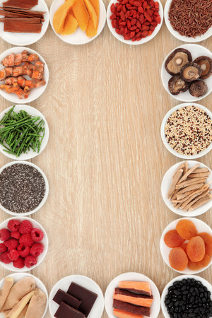superfood: Healthy superfood abstract border over oak wood background