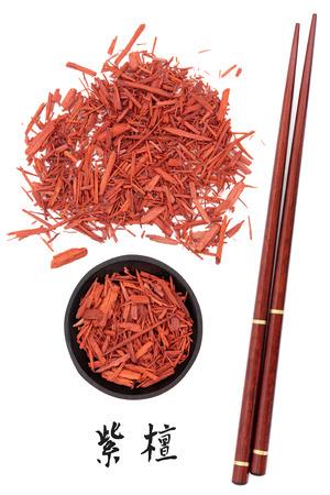 sandalwood: Sandalwood chinese herbal medicine and chopsticks with mandarin script title translation  Tan xiang  Santalum album