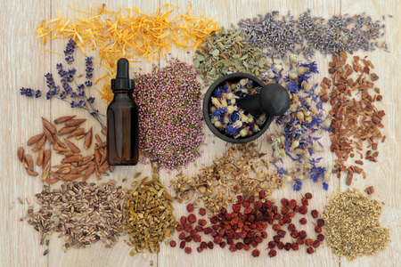 essential oil: Herbal medicine selection also used in magical potions over oak background