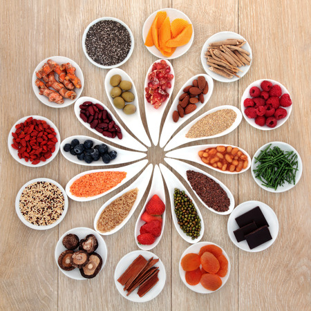 pulses: Healthy super food selection in white porcelain bowls over oak wood background Stock Photo