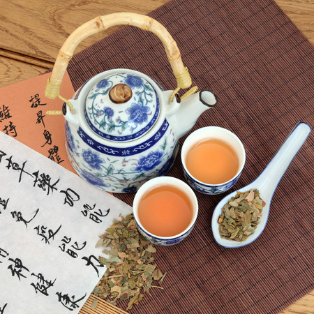 xing: Ginkgo herb green tea with oriental style tea pot and spoon with chinese calligraphy  Yin xing  Stock Photo