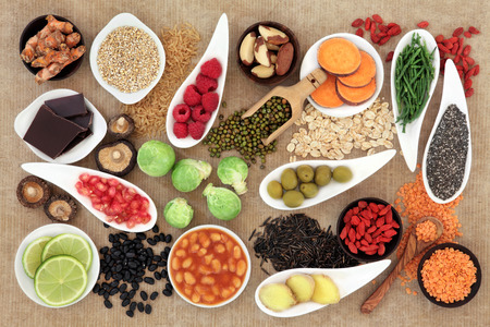 superfood: Health food selection over  brown paper background