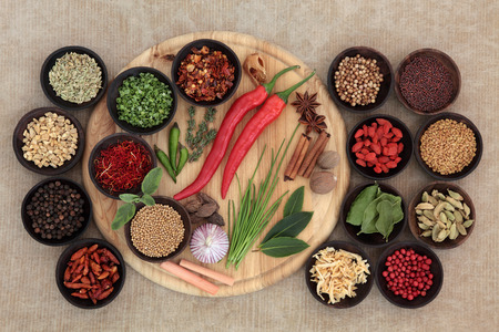 dried herbs: Large herb and spice selection on a wooden board, in bowls and loose