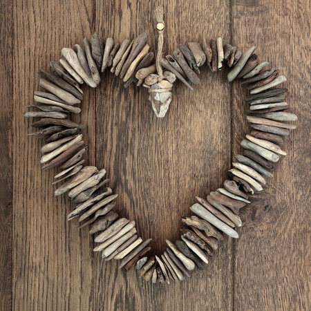 driftwood: Driftwood love heart with small wooden pieces over old oak background