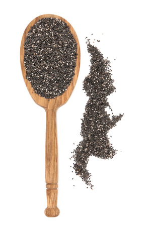 white salvia: Chia seed healthy super food in a rustic wooden spoon over white background  Salvia hispanica  Stock Photo