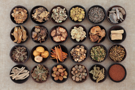 tcm: Large traditional chinese herbal medicine selection in wooden bowls