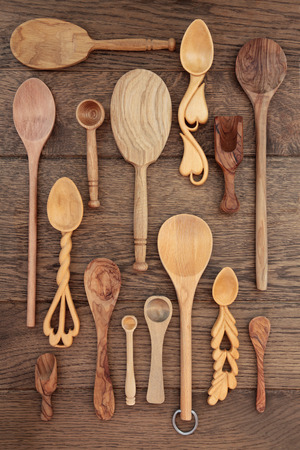 sampler: Rustic wooden kitchen utensils over old oak background  Stock Photo