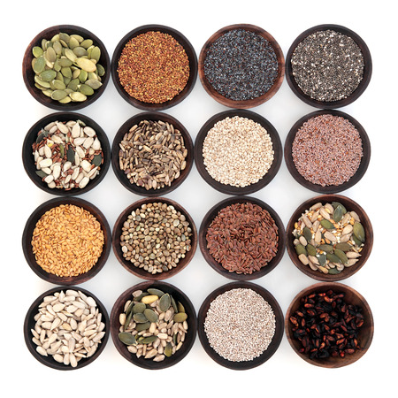 Seed super food selection in wooden bowls over white background