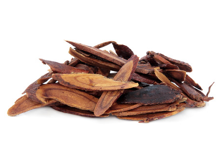 Liquorice root honey baked used in chinese herbal medicine over white background  Zhi gan cao