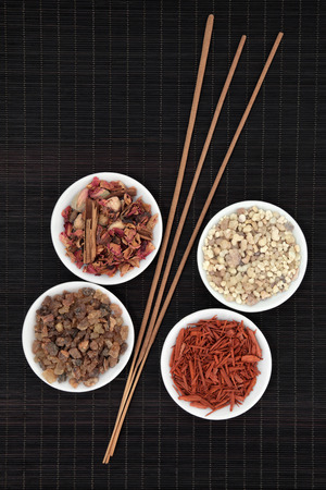 myrrh: Frankincense, myrrh, sandalwood, pot pourri and incense sticks over bamboo background
