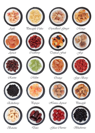 Large dried fruit selection in white bowls on slate rounds over white background with titles photo