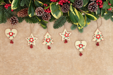 christmas background border with old fashioned wooden decorations fir holly ivy mistletoe - Old Fashioned Paper Christmas Decorations